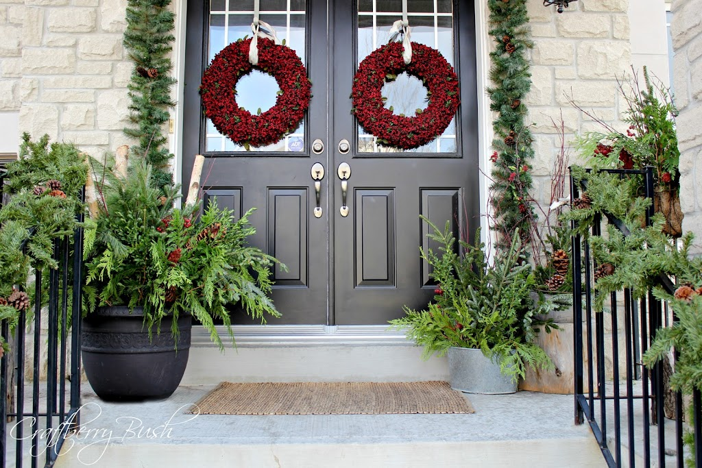 The front porch and helping christmas evergreens last longer for Decorating a small front porch for christmas