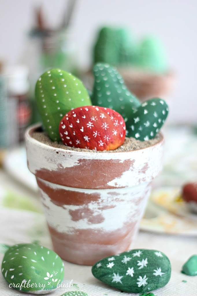 Adorable cacti made out of painted rocks