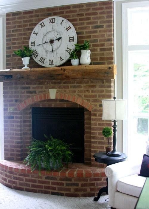 DIY-Spool-Clock-above-fireplace-e1436879818365 (1)
