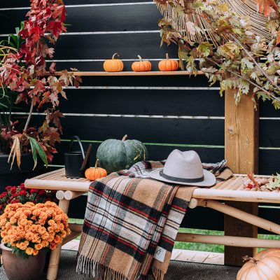 Backyard Seating Area Decorated for Fall